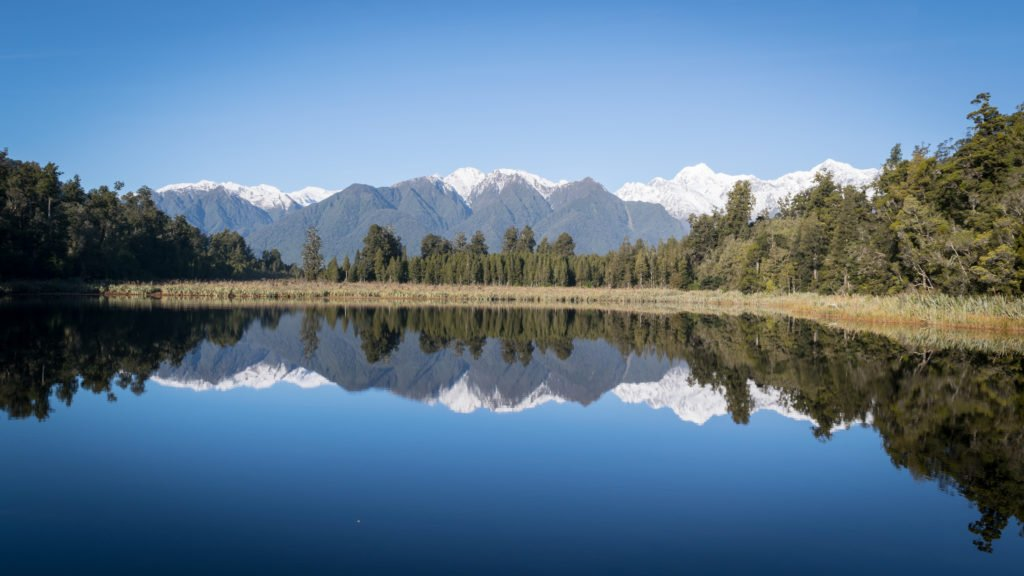 new zealand lake matheson reflective view on mount cook and mount tasman