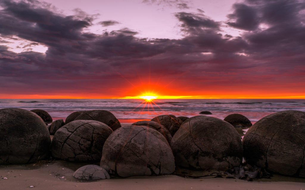 new zealand moeraki boulders at sunrise