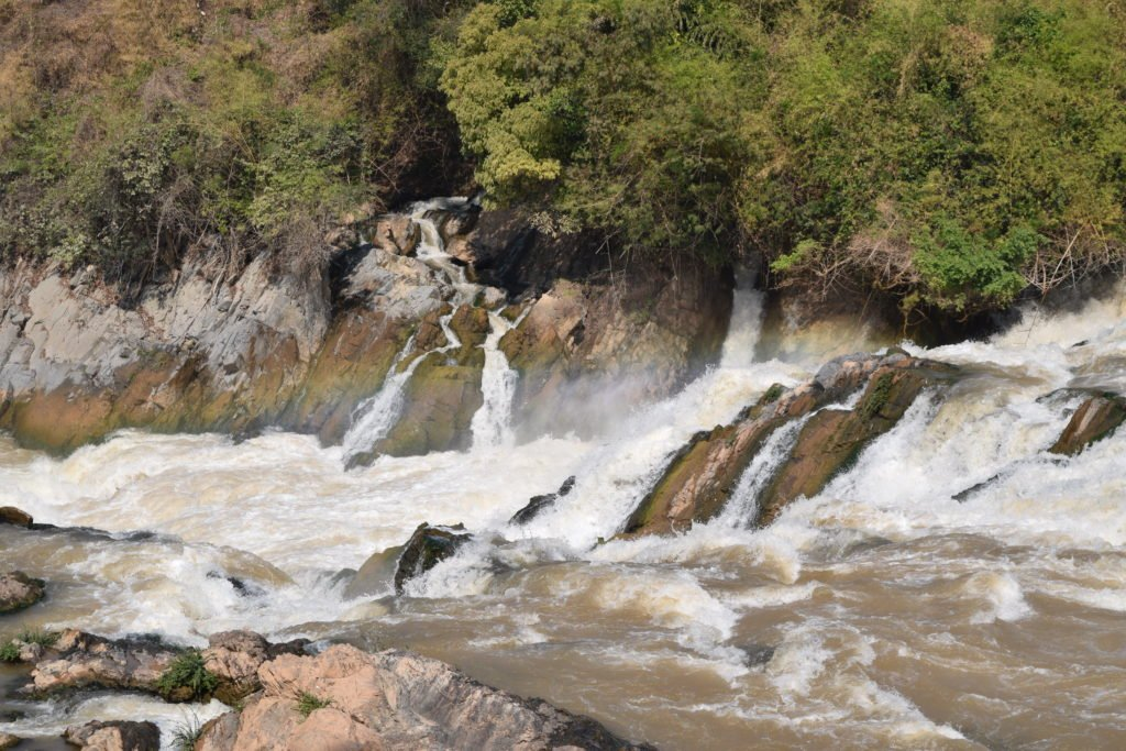 A Section of Khone Phapheng Falls with a sprinkle of rainbow