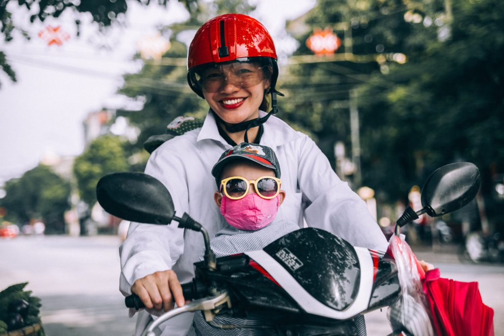 vietnam mom and son on motorcycle with helmets