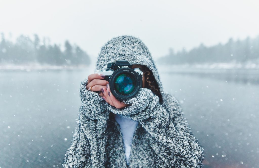winter-lady-holding-a-camera
