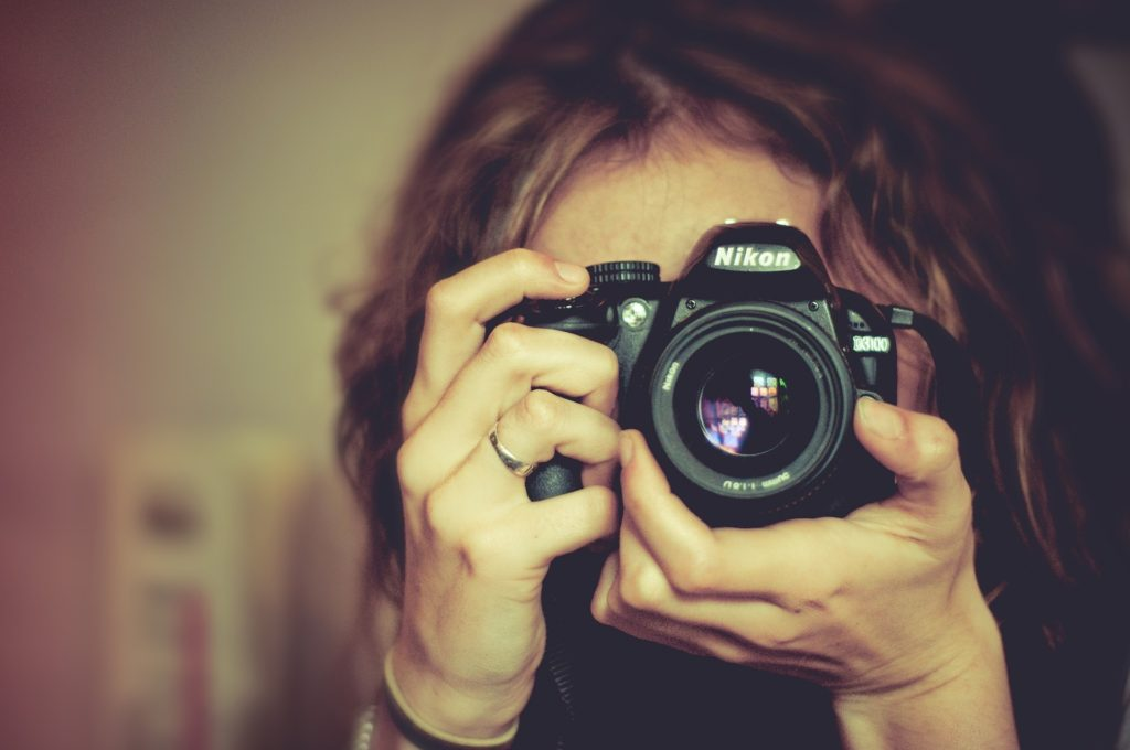 young-girl-holding-a-nikon-camera