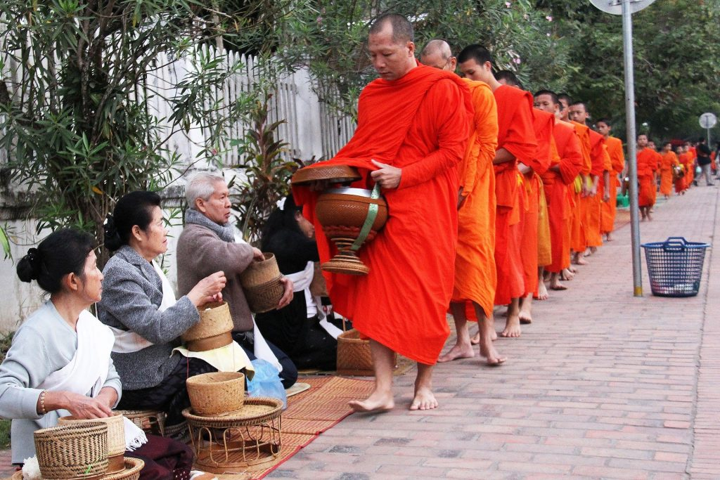 laos luang prabang morning alms giving ceremony monks