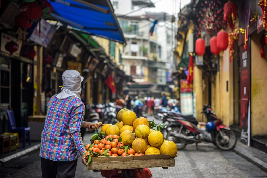 Vietnamese Hawker Selling Fruits on Bicycle
