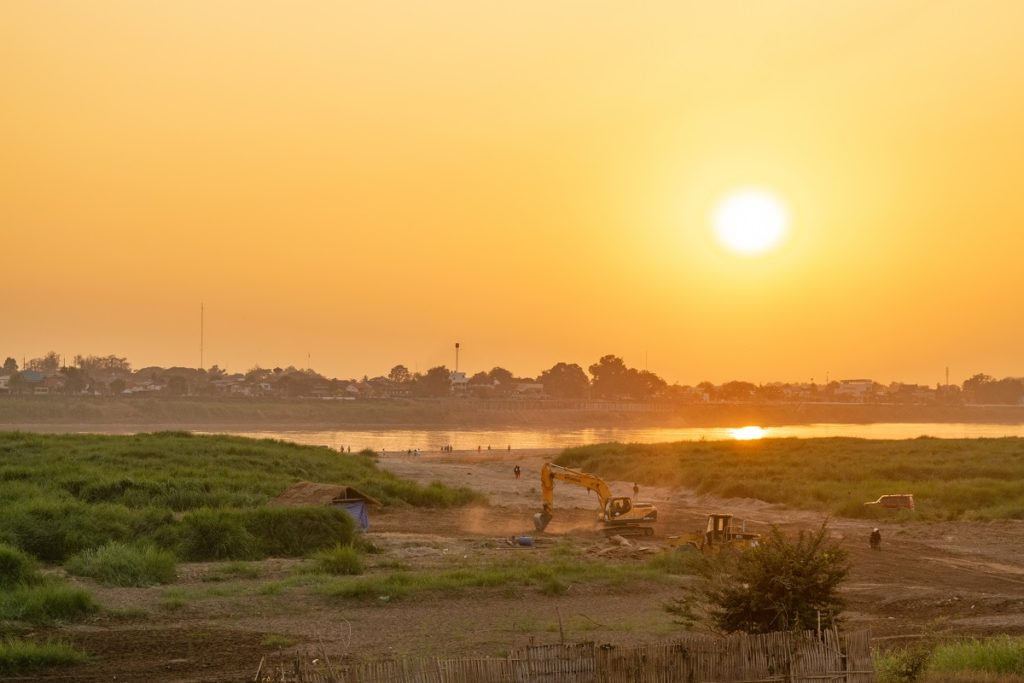 Vientiane Chao Anouvong Park Sunset Over Mekong River Thailand Border